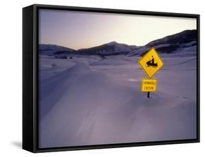 """""""Snowmobile Crossing"""" Sign in a Snowdrift by Michael Melford"""