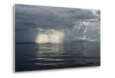 Sunlight Breaking Through a Hole in Storm Clouds