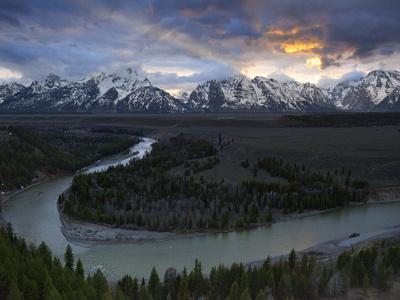Sunrise Gleams Behind the Teton Range and the Snake River