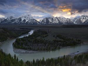 Sunrise Gleams Behind the Teton Range and the Snake River by Michael Melford