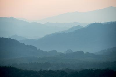 The Hills Surrounding the Mekong River Valley at Sunset by Michael Melford