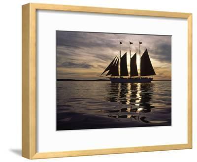Three Masted Schooner under Sail at Sunset