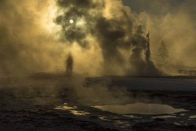 A Woman Vanishes into Steam Clouds from Tardy Geyser in Yellowstone's Upper Geyser Basin