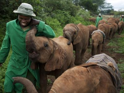 Elephant Orphans Form Intense Bonds With Their Caregivers and Vice Versa by Michael Nichols
