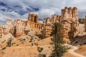 Hikers amongst hoodoo formations on the Fairyland Trail in Bryce Canyon National Park, Utah, United by Michael Nolan