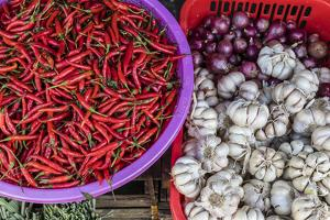Red Chillies, Onions, and Garlic for Sale at Fresh Food Market in Chau Doc by Michael Nolan