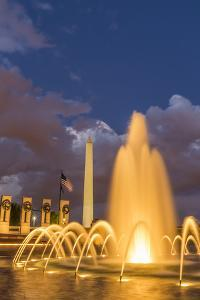 The Washington Monument Lit Up at Night as Seen from the World War Ii Monument by Michael Nolan