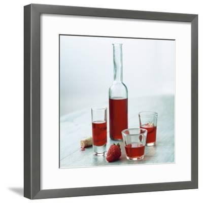 Strawberry Liqueur in Bottle and Three Different Glasses