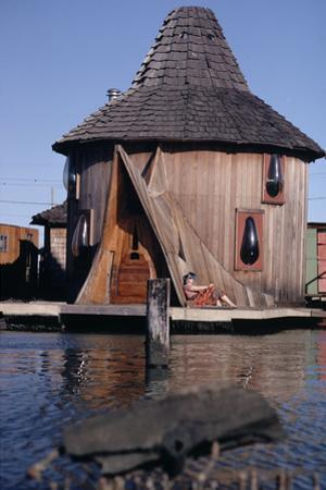 1971: Floating-Home Owner Mary Holt Sunbathes on the Deck of Her House, Sausalito, California