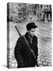 Boy Freedom Fighter Carrying Rifle During Hungarian Revolution Against Soviet Backed Government by Michael Rougier