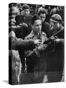 Budapest Boys Carrying Rifles to Fight with Hungarian Freedom Fighters Against Soviet-Backed Regime by Michael Rougier