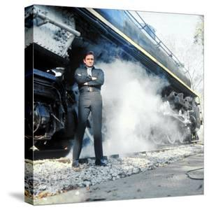 Country Music Star Johnny Cash Wearing Black Clothing and Standing in Front of a Locomotive by Michael Rougier