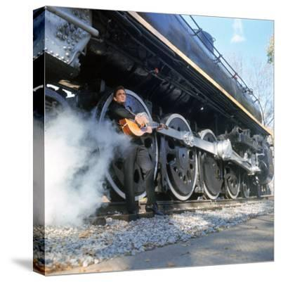 Country/Western Singer Johnny Cash W. Guitar by Wheels of a Steam Train