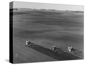 Farmers Planting Corn on Hamilton Farm by Michael Rougier