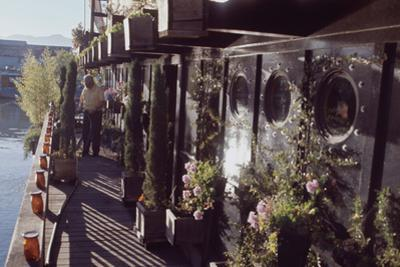 Floating-Home Owner Warren Owen Fonslor Waters the Plants on His Deck, Sausalito, CA, 1971
