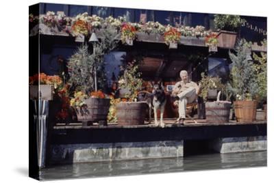 Floating-Home Owner Warren Owen Fonslor with His German Shepherd, Sausalito, CA, 1971
