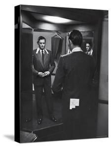 Gregory Peck Trying on Suit for His New Movie Man in the Grey Flannel Suit by Michael Rougier
