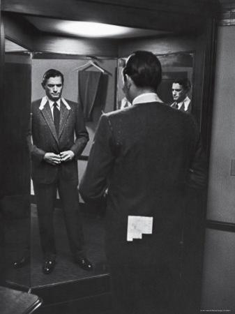 Gregory Peck Trying on Suit for His New Movie Man in the Grey Flannel Suit