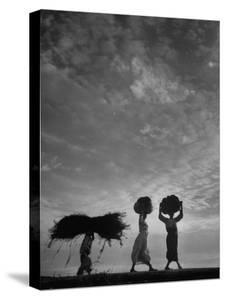 Korean Peasants Carrying Bundles on Their Heads by Michael Rougier