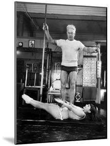 Opera Singer Roberta Peters Balancing Her Trainer, Joseph Pilates, on Her Operatic Breadbasket by Michael Rougier