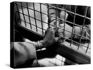 Prisoner Ronald Gallagher and Wife Holding Hands by Michael Rougier