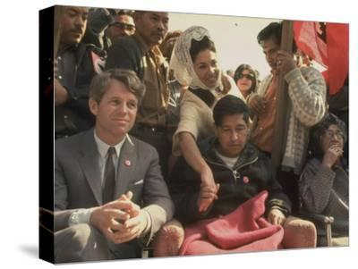 Robert F. Kennedy Sitting Next to Cesar Chavez During Rally for the United Farm Workers Union