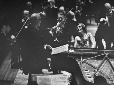 Sir Thomas Beecham Conducting Orchestra as Lady Beecham Plays Piano