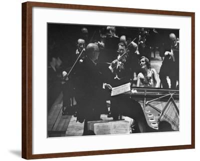Sir Thomas Beecham Conducting Orchestra as Lady Beecham Plays Piano