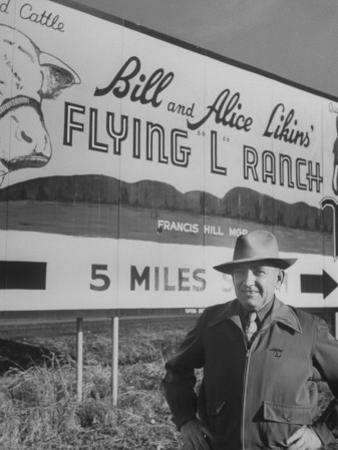 Super Rich Texas Millionaires William Likins Standing in Front of Sign at Main Entrance to Ranch