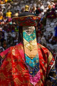 Costumed Dancers at Religious Festivity with Many Visitors, Paro Tshechu, Bhutan by Michael Runkel
