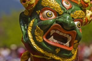 Mask of Dancer at Religious Festivity with Many Visitors, Paro Tsechu, Bhutan, Asia by Michael Runkel