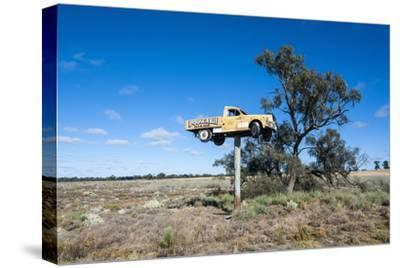 Old Truck on a Huge Pole