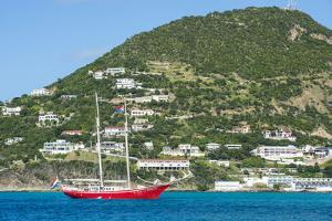 Red sailing boat in the bay of Philipsburg, Sint Maarten, West Indies, Caribbean, Central America by Michael Runkel