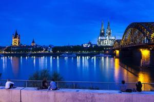 Rhine Bridge and Cathedral of Cologne Above the River Rhine at Night by Michael Runkel