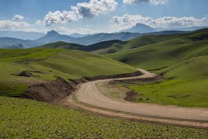 Road Leading Through Green Scenery around Darbandikhan Artificial Lake on Border of Iran, Kurdistan by Michael Runkel