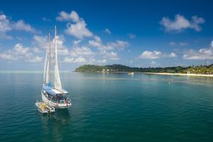 Sailing boat anchoring on Mana Island, Mamanuca Islands, Fiji, South Pacific by Michael Runkel