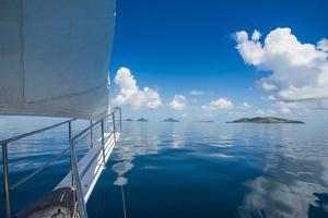 Sailing in the very flat waters of the Mamanuca Islands, Fiji, South Pacific by Michael Runkel