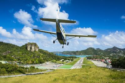Small airplane landing at the airport of St. Barth (Saint Barthelemy), Lesser Antilles, West Indies