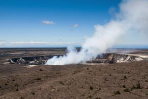 Smoking Kilauea Summit Lava Lake in the Hawaii Volcanoes National Park by Michael Runkel