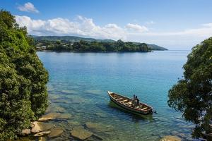 View over a Canoe on Nkhata Bay, Lake Malawi, Malawi, Africa by Michael Runkel