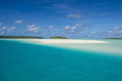 White sand beach and palm fringed beach in Aitutaki lagoon, Rarotonga and the Cook Islands, South P by Michael Runkel