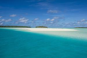 White sand beach and palm fringed beach in Aitutaki lagoon, Rarotonga and the Cook Islands, South P by Michael Runkel