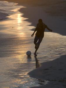Young Man Playing Football at Sandbeach in Twilight, Santa Maria, Sal, Cape Verde, Africa by Michael Runkel