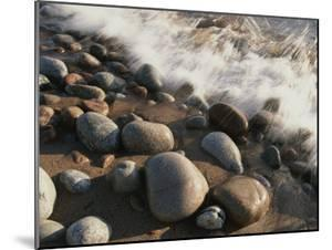 A Close View Time Exposure of Surf Washing over Stones on the Beach by Michael S. Lewis