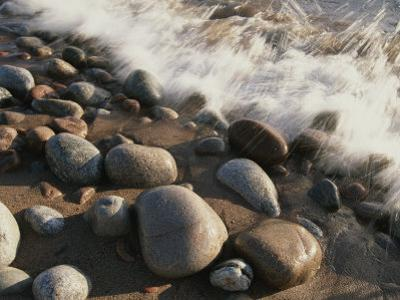 A Close View Time Exposure of Surf Washing over Stones on the Beach by Michael S^ Lewis