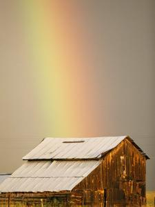 A Rainbow Arches from the Sky onto a Barn by Michael S. Lewis
