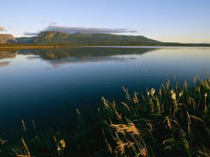 Scenic View of a Large Pond and Hills at Twilight by Michael S. Lewis