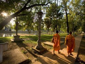 Two Buddhist Monks Walk Along the Siem Reap River at Sunrise, Cambodia by Michael S. Lewis