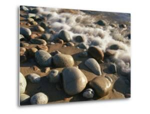 Water Washes up on Smooth Stones Lining a Beach by Michael S^ Lewis