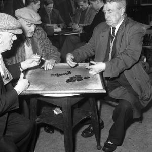 A Game of Dominoes in a Miners Welfare Club, Horden, County Durham, 1963 by Michael Walters